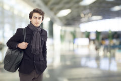 Young man at airport Stock Photo