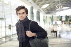 Young man at airport Royalty Free Stock Photos