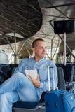 Young man at the airport Royalty Free Stock Photos