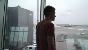 Young man in airport terminal stock footage