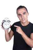 Young man with alarm clock. On white background Royalty Free Stock Photo