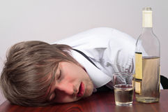 Young man with alcohol Royalty Free Stock Images