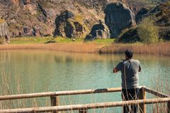 A young man alone on a lake, portrait, la arboleda, basque country stock image