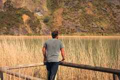 A young man alone on a lake, portrait, la arboleda, basque country stock images