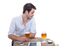 Young man alone on the terrace of a bar Royalty Free Stock Image