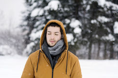 Young man  alone in the winter park Royalty Free Stock Photos