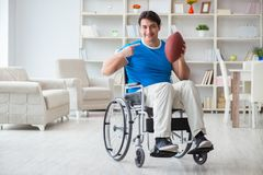 The young man american football player recovering on wheelchair Stock Images