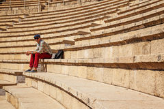 Young man. In amphitheatre of ancient city in israel Stock Images