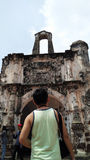 A Young Man Amuse the Porta de Santiago in Malacca, Malaysia Royalty Free Stock Photo