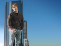 Young Man And Building With Sky Stock Photo
