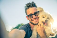 Young Man And His Dog Taking A Selfie Royalty Free Stock Image