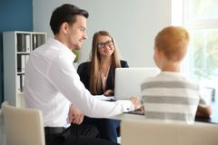 Free Young Man And His Son Meeting With Headmistress At School Stock Photo - 151243490