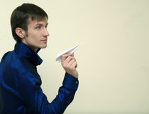 Young Man And Paper Airplane Royalty Free Stock Photography