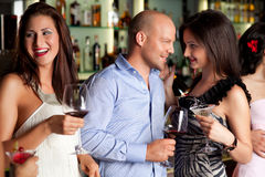 Young Man And Wemen At The Bar Stock Photo