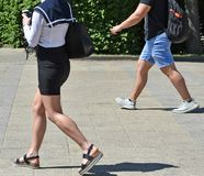 Free Young Man And Woman Are Walking On The Street Royalty Free Stock Image - 116875766