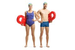 Free Young Man And Woman In Swimming Suit Holding Swimming Floats Royalty Free Stock Image - 153482376