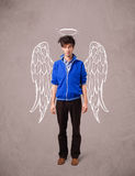 Young man with angel illustrated wings Royalty Free Stock Images