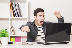Young man angry with computer Stock Photos
