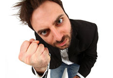 Young man with angry expression. On white background Stock Photography