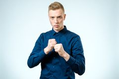 Young man angry gesturing fist raised Royalty Free Stock Images
