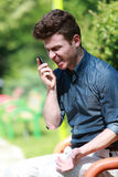 Young man angry on telephone Royalty Free Stock Photo