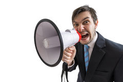 Young man is announcing a message and shouting to megaphone. Isolated on white background Stock Photography