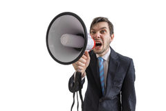 Young man is announcing a message and shouting to megaphone. Isolated on white background Royalty Free Stock Photo