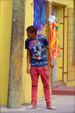 Young man in Antigua. People in Antigua - young guy wearing bright clothes, Caribbean stock photo