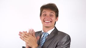 Young man applauding. White background stock video footage
