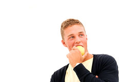 Young man with apple Stock Images