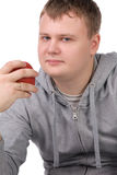 Young man with apple Stock Photography