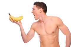 Young man with apple. Full isolated studio picture from a young naked man with underwear and banana Royalty Free Stock Image