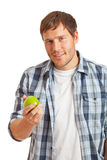 Young man with apple Royalty Free Stock Image