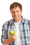 Young man with apple Royalty Free Stock Images