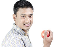 Young man with apple in hand Royalty Free Stock Photo