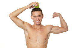 Young man with apple Stock Photo