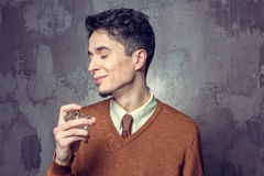 Young man applying fragrance Stock Photography