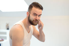 Young man applying shaving cream Royalty Free Stock Images