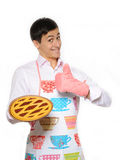 Young man in apron baked tasty pie Royalty Free Stock Image