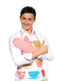 Young man in apron preparing to cook Royalty Free Stock Images