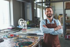 Smiling master in an apron Stock Image