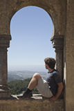 Young man in arabian arch of  Pena palace, Sintra Royalty Free Stock Image