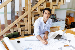 Young man architect in office Stock Photos