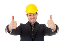 Young man architect thumbs up. Young cheerful caucasian man architect with helmet and thumbs up. Positive atitude. Studio shot. White background Stock Photos