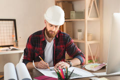 Young man architect working in the office ocuupation Royalty Free Stock Photos