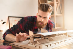 Young man architect working in the office ocuupation. Young male architect working indoors model construction stock image