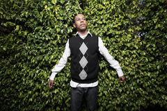 Young man in an argyle sweater Stock Photos
