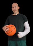 Young man in an arm cast after a basketball accident Royalty Free Stock Photo