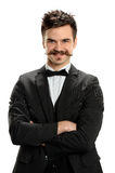 Young Man With Arms Crosses and Fancy Mustache Stock Photography