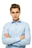 Young man with arms folded Stock Photography